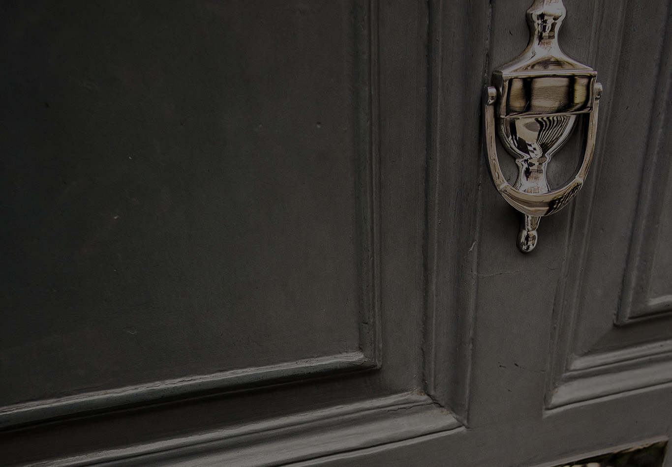 A close up of a door with a brass colored knob