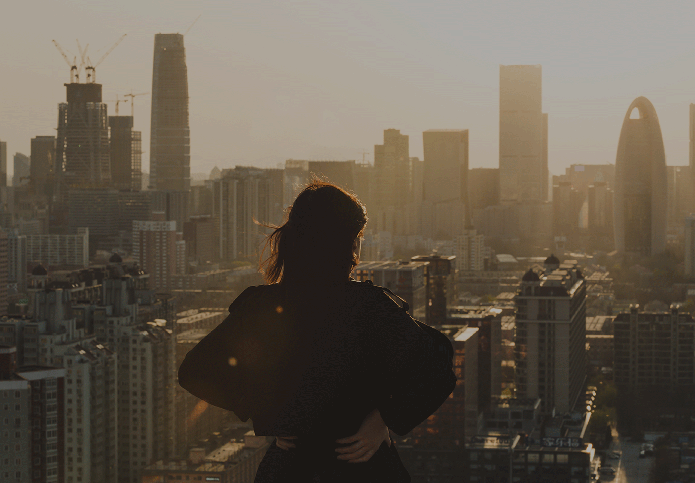 Woman looking at the skyline of a metropolitan city.