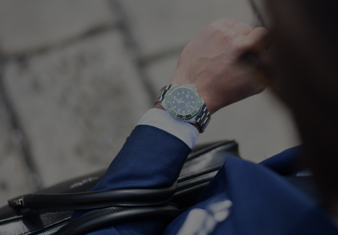A watch on a person's wrist is in focus in the picture